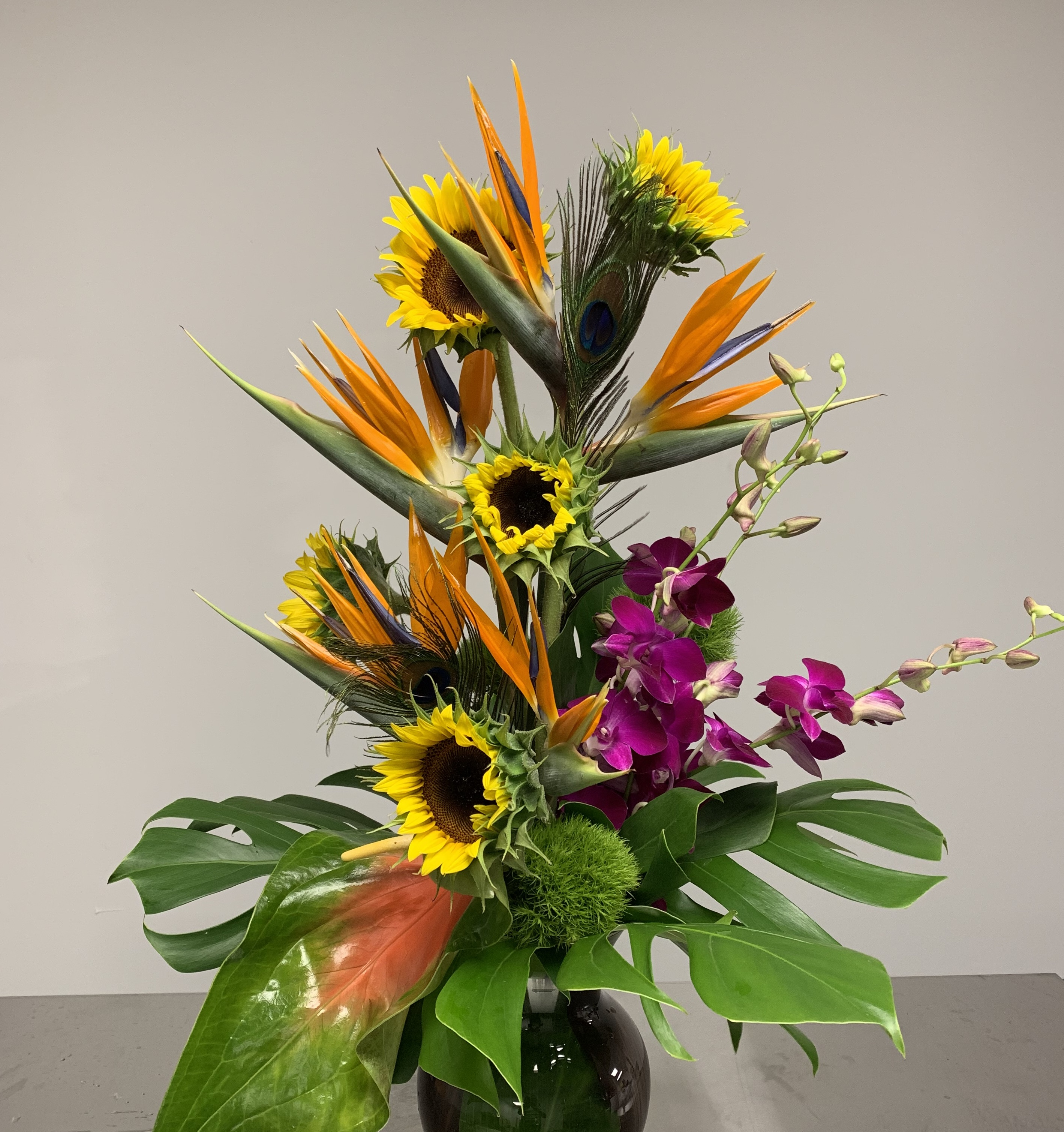 Long bright Sunflowers with Tropical Flowers and Orchids Velene's Floral