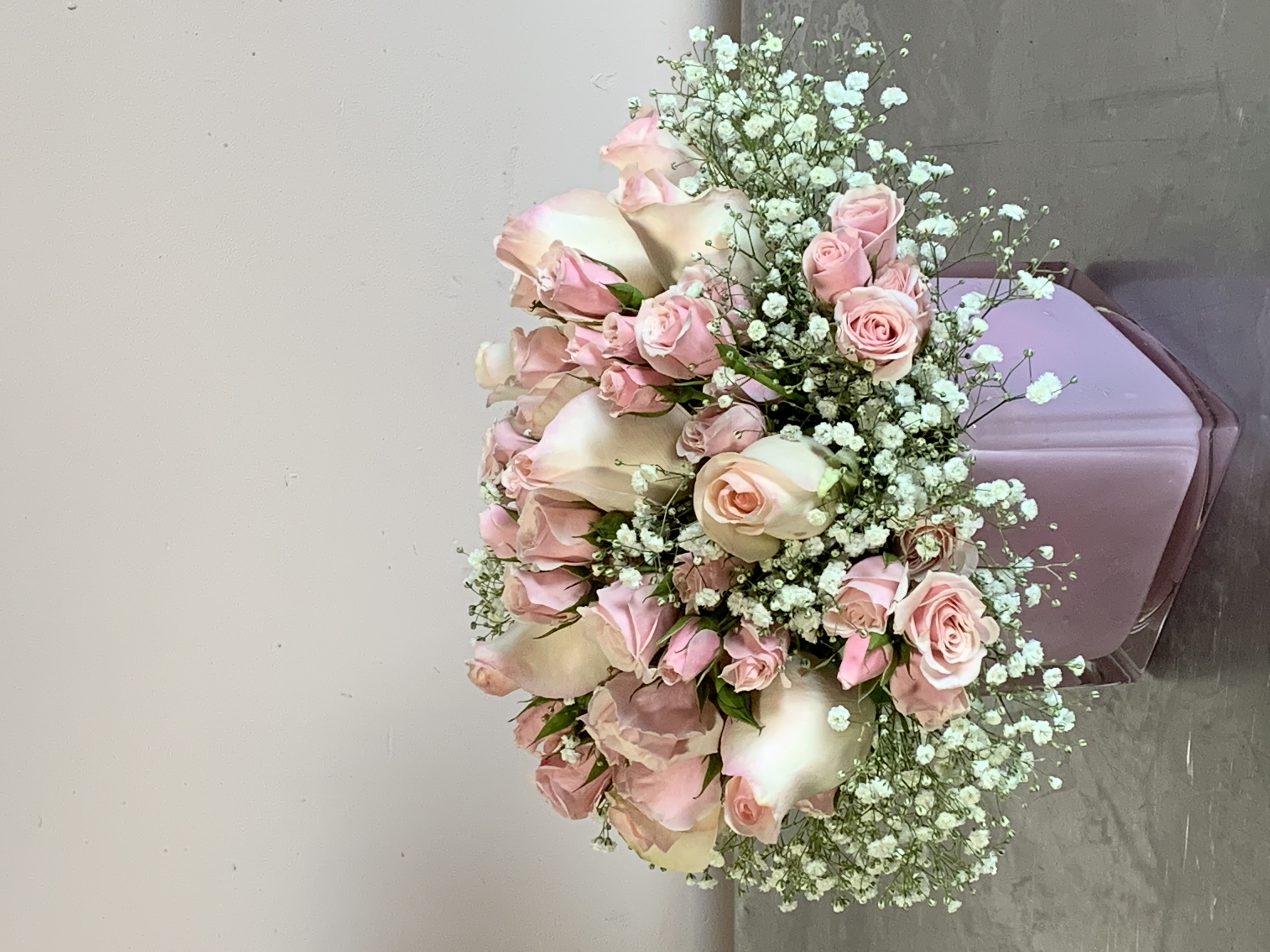 Roses surrounded with Baby's Breath Velene's Floral
